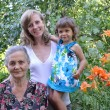 Family portrait in a garden, three generations — Stock Photo