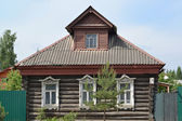Old log house with carved platbands — Stock Photo