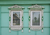 Two windows with carved platbands — Stock Photo