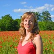 Portrait of the young woman in a poppy field — Stock Photo