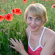 Stock Photo: Portrait of womof average years with red poppies