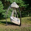 Suspension hammock seat with pillows outdoors — Foto de Stock