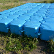 Stock Photo: Plastic modular pontoon lies on grass