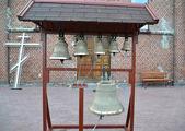 Church bells on a figurative folding belfry — Stock Photo