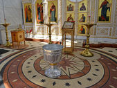 Interior of orthodox church with a font for a baptism — Stock Photo