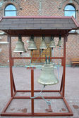 Church bells on a figurative folding belfry — Стоковое фото