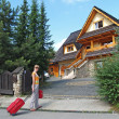 Stock Photo: Tourist goes to country house to Zakopane, Poland