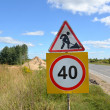 """Road signs """"Roadwork"""" and """"Restriction of maximum speed of 40 km — Stock Photo"""