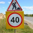 "Road signs ""Roadwork"" and ""Restriction of maximum speed of 40 km — Stock Photo #31655517"