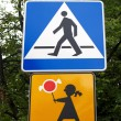 "Road signs ""Crosswalk"" and ""Carefully, children"" against greens — Stock Photo"