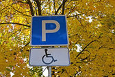 """Road sign """"A parking lot for drivers of disabled people"""" — Stock Photo"""
