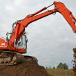 The excavator works at soil movement — Stock Photo