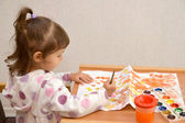 The little girl draws water color paints — Stock Photo