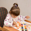 Stock Photo: Little girl draws water color paints