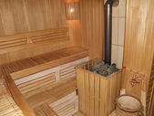 Sauna interior with the furnace — Stock Photo