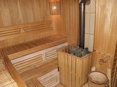 Sauna interior with the furnace — Stock Photo