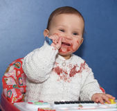 The little girl independently eats with a spoon — Stock Photo