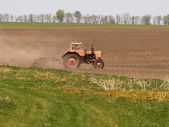 Spring processing weeding a tractor — Stock Photo