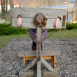 Foto de Stock  : Pillory in lock Ryn, Poland. Punishment imitation