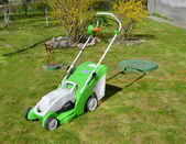 Lawn-mower complete with the container for a grass — Photo
