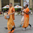 Krishnaites go down the street Prague, the Czech Republic — Stock Photo #50869929
