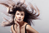 Fashion woman with flying hair — Stock Photo