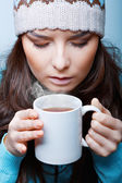 Woman in hat with hot tea — Stock Photo