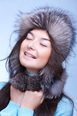 Happy woman in fur cap — Stock Photo