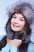 Happiest woman in a fur cap — Stock Photo