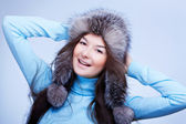 Joyful woman in fur cap — Stock Photo