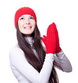 Woman in red cap and mittens rejoices — Stock Photo