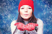 Christmas woman blowing snow — Stock Photo