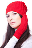 Beauty woman in a red cap and mittens — Stock Photo