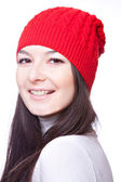 Face of beautiful girl in red cap — Stock Photo