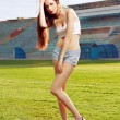 Fashion woman on football grass — Stock Photo