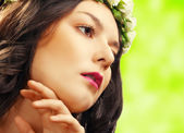 Beauty woman with flower on green — Stock Photo