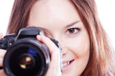 Smiling woman with professional camera — Stock Photo