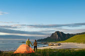 Couple with tent — Stock Photo