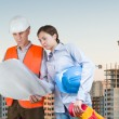 Foreman and engineer with blueprints — Stock Photo #29634325
