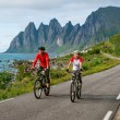 Two cyclists relax biking — Stock Photo #29634387