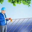 Engineer installing solar panels — Stock Photo