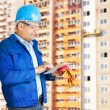 Foreman with blueprints — Stock Photo