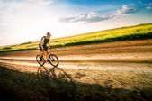 Man biking in motion — Stock Photo