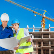 Foreman and engineer with blueprints — Stock Photo