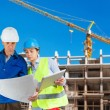 Foreman and engineer with blueprints — Stock Photo #36491307