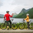 Two cyclists relax biking — Stock Photo #36491315