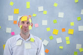 Businessman with many notes — Stock Photo