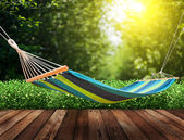Relaxing on hammock in garden — Stock Photo