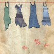 Foto Stock: Summer dresses on sale. Old paper background