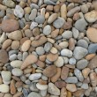 Background made of a closeup of a pile of pebbles — Stock Photo